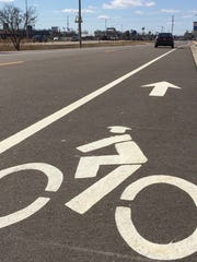 Grand Chute marked bike lanes on the West College Avenue frontage road between Lilas and Bluemound drives.