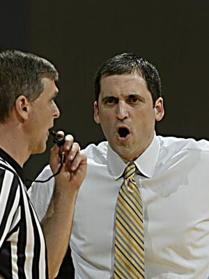 Murray State Racers coach Steve Prohm argues a call with a referee during a 2012 game against the St. Marys Gaels at the CFSB Center. Murray State defeated St. Marys 65-51.