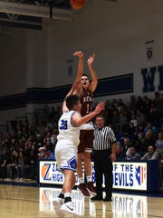 J.T. Shumate shoots a 3-pointer over Cobe Curry during the first quarter of Newark's 65-56 win against host Zanesville on Saturday night at Winland Memorial Gymnasium.