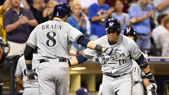 Ryan Braun celebrates with Aramis Ramirez after a third-inning home run against the Padres.
