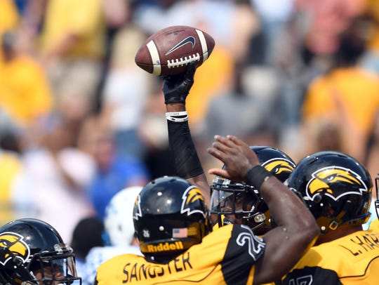 Southern Miss defensive back Tarvarius Moore recovers a fumble in a game against Kentucky at M.M. Roberts Stadium.