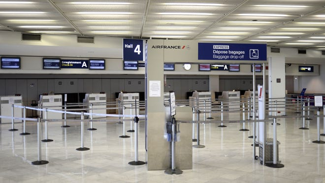 This photo from Sept. 27, 2014 shows a deserted Air France check-in area at the Paris Orly airport.
