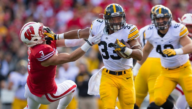 Iowa running back Jordan Canzeri (33) gained 128 yards against Wisconsin on Saturday.
