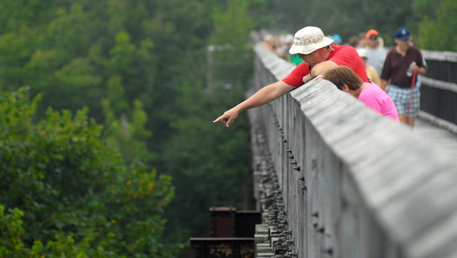 Les Boyes, of Avoca, points out into Mill Creek, Mon, Sept 1, during the annual Trek the Trestle Trail Walk in Avoca.
