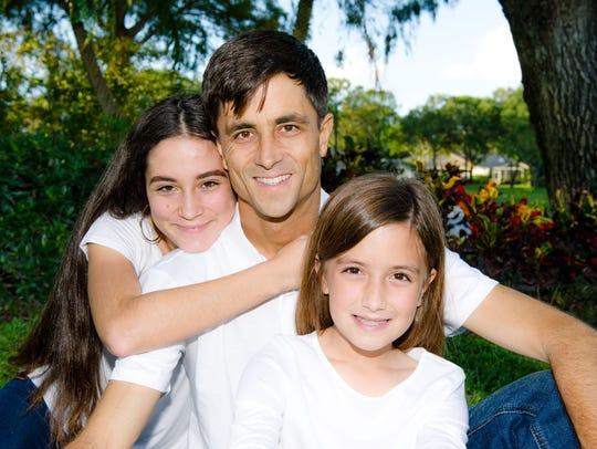 Jonathon Gosman with his daughters Milani and Miriana