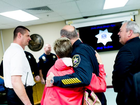 Attendees hug during an awards ceremony at the Loudon County Sheriff's Office in Knoxville, Tennessee on Thursday, February 15, 2018. Two Loudon County Sheriff's deputies and a Lenoir City Police officer were honored for their heroic efforts in saving residents of an apartment duplex last week.