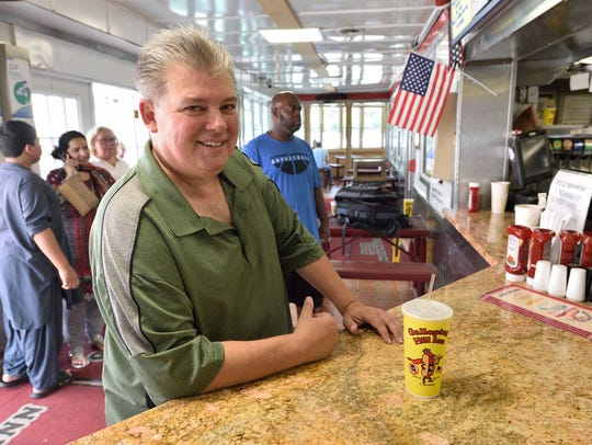 Hot Dog expert John Fox at the counter of the Galloping