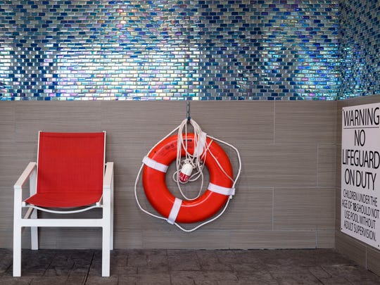A life ring hangs on the wall at the indoor pool at the Holiday Inn Express on Papermill Drive on Monday, May 21, 2018. When pools do not have life guards, rescue equipment like life rings and a phone line are required by the health department.