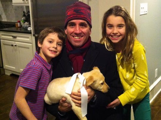 """Beau Biden posted this picture on his personal Twitter account Feb. 8, 2014, writing """"Thank you to my wife & kids for the newest addition (& biggest birthday surprise) to our family, Liberty (aka Libby)!?"""""""