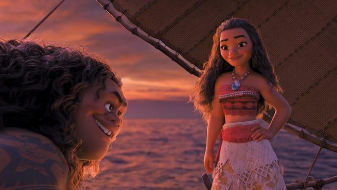 The demigod Maui (voice of Dwayne Johnson) helps teenage adventurer Moana (Auli'i Cravalho) in 'Moana.'