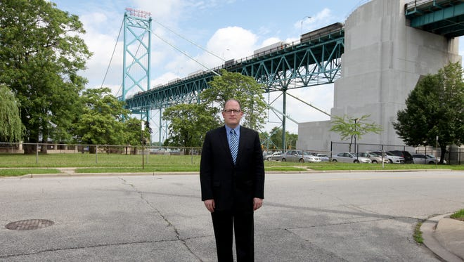 City of Windsor Mayor Drew Dilkens stands on the corner of University W. and  Indian street where the proposed second bridge span would be, next to the existing Ambassador Bridge in the Sandwich neighborhood of Windsor OntarioMonday, June 15, 2015