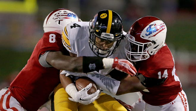 Hoosiers linebacker Tegray Scales (8) and Andre Brown Jr. (14) combine to make a tackle vs. Iowa.