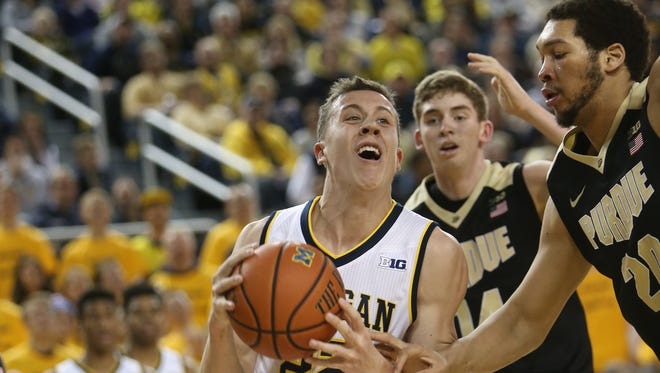 University of Michigan Wolverines Duncan Robinson drives against the Purdue Boilermakers A.J. Hammonds during second half action on Saturday, February 13, 2016 at Crisler Center in Ann Arbor.