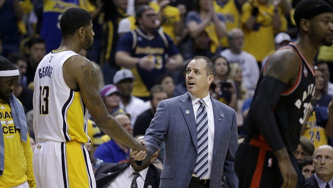 Indiana Pacers head coach Frank Vogel congratulates Paul George late in the second half of their Eastern Conference first round playoff game Saturday, April 23, 2016, afternoon at Bankers Life Fieldhouse. The Pacers defeated the Raptors100-83.
