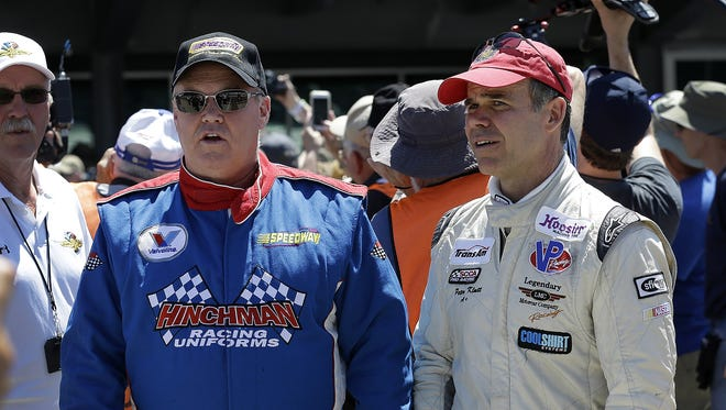 Al Unser Jr.,right, and his teammate Peter Klutt, left, before the start of  the Indy Legends Charity Vintage Pro/Am race  at the SVRA Brickyard Vintage Racing Invitational Saturday, June 18, 2016, at the Indianapolis Motor Speedway.