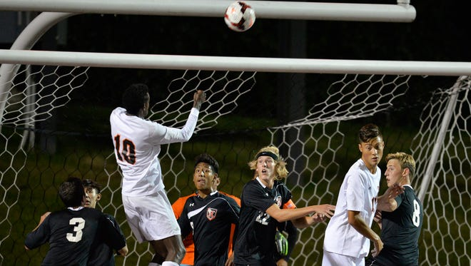 Rocori players crowd the goal to try to protect against a header from St. Cloud Tech's Mohamed Abdi (10) in the second half Tuesday, Sept. 20, at Husky Stadium.