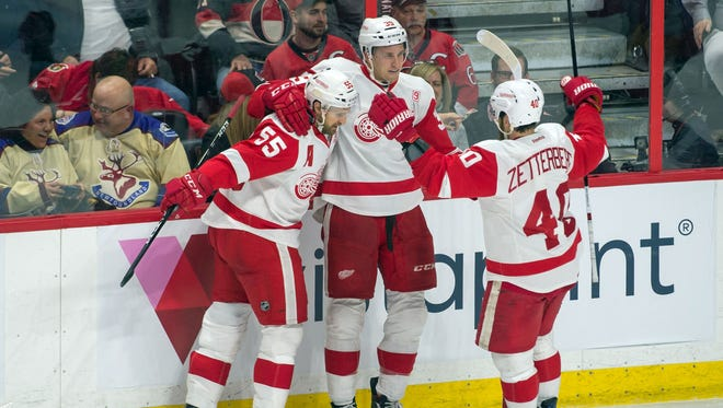 Dec 29, 2016; Ottawa, Ontario, CAN; The Detroit Red Wings celebrate a goal scored by Anthony Mantha (39) in overtime against the Ottawa Senators at the Canadian Tire Centre. The defeated the Red Wings defeated the Senators 3-2.