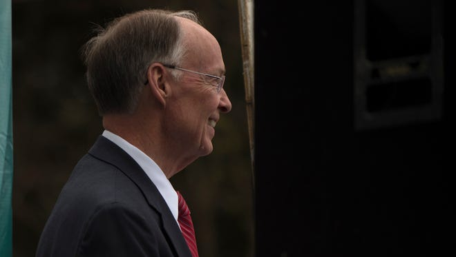 Governor Robert Bentley looks on during the Higher Education Day Rally and March outside the Alabama State House building on Thursday, Feb. 23, 2017, in Montgomery, Ala.