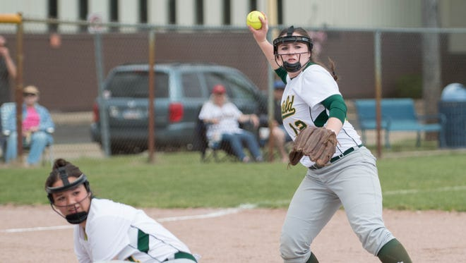 Pennfield's Kaylee Clothier throws back to first during All-City Softball finals on Saturday.