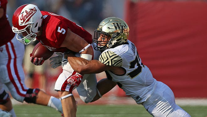 Indiana Hoosiers running back Cole Gest (5) tries to escape a tackle by Wake Forest Demon Deacons defensive back Ryan Janvion (22) during first half action at Memorial Stadium, Bloomington, Ind., Saturday, September 24, 2016.
