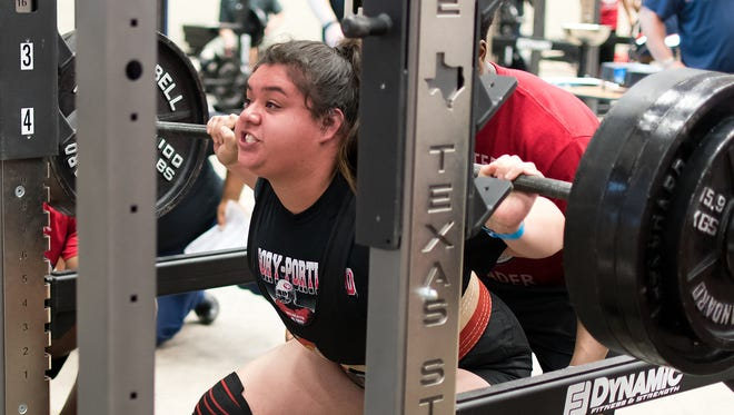 Gregory-Portland's Luci Zamora tries to drive up a squat attempt at the Texas High School Women's Powerlifting Association State Championships Friday at the Extraco Events Center in Waco. Zamora, a senior, won the 220-pound 5A state championship.
