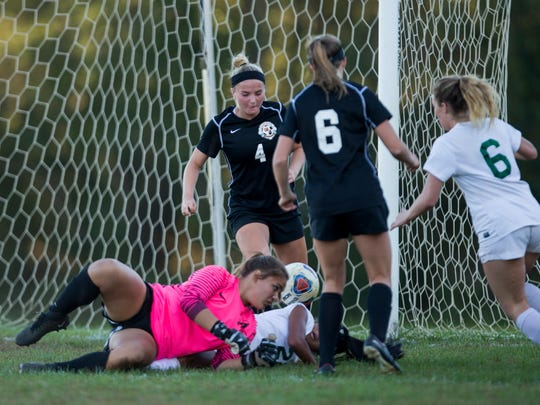 Middletown North goalie Haley Martin and Colts Neck's Kayla Lee battle on ground for loose ball during second half action. Colts Neck Girls Soccer defeats Middletown North on October 19,  2017 in Colts Neck, NJ.