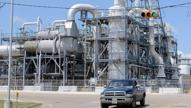A truck leaves the Dow Chemical plant in Freeport, Texas, in September 2008.