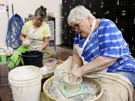 In this file photo, Ann Hunter, right, and Anne-Marie Williamson make bowls at the 2018 Wichita Falls Area Food Bank Bowl-A-Thon at the Midwestern State University Fain Fine Arts building.