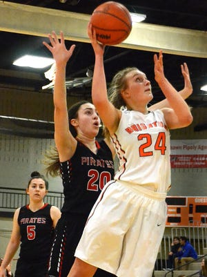 Brighton's Sophie Dziekan gets inside position on Pinckney's Maya Narayan to take a shot in the Bulldogs' 50-21 victory.