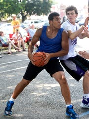 Louie Minaya, playing for Cedar Crest, pushes inside during  the championship game at Saturday's Sweep the Streets High School Basketball Tournament in Lebanon, June 25, 2016.