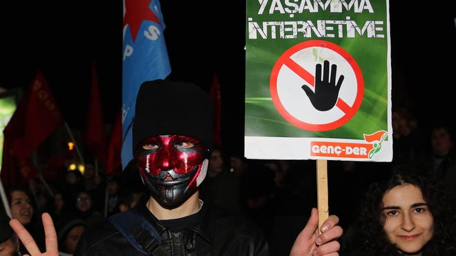 "A masked man holds a placard that reads ""don't touch my life and my Internet"" during a rally in Ankara, Turkey, last month against a bill that would, among other things, allow Turkey's telecommunications authority to directly block access to websites or remove content deemed to be violating privacy without a court decision."