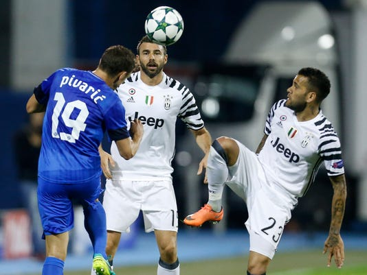 FILE  - In this Sept. 27, 2016 file photo, Juventus's Leonardo Bonucci, background, Zagreb's Josip Pivaric, left, and Juventus's Dani Alves, right, challenge for the ball during the Champions League Group H soccer match between Dinamo Zagreb and Juventus, at Maksimir stadium in Zagreb, Croatia, Tuesday, Sept. 27, 2016. Juventus will face Real Madrid in the Champions League final in Cardiff, Wales, on Saturday, June 3, 2017.  (AP Photo/Darko Bandic, File)