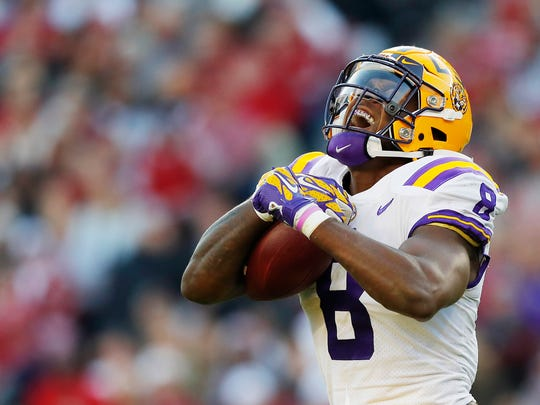 Patrick Queen #8 of the LSU Tigers celebrates after intercepting a pass during the second quarter against the Alabama Crimson Tide in the game at Bryant-Denny Stadium on November 09, 2019 in Tuscaloosa, Alabama