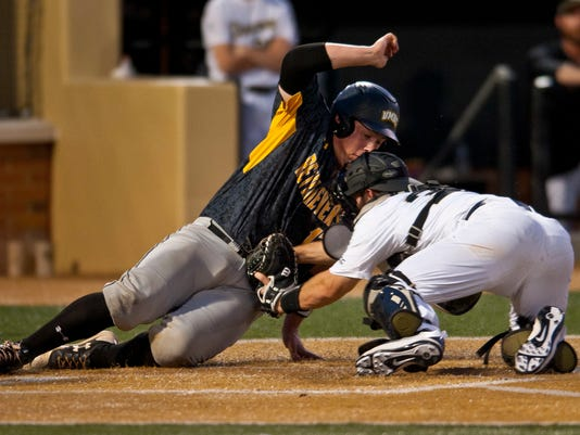 Wake Forest catcher Ben Breazeale tags out UMBC's Hunter Dolshun at the plate in the sixth inning of an NCAA college baseball tournament regional game, Friday, June 2, 2017, in Winston-Salem, N.C. (Walt Unks/Winston-Salem Journal via AP)