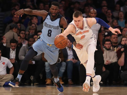 Knicks forward Kristaps Porzingis (6) reaches for the ball as Grizzlies forward James Ennis III (8) steps in during Monday's game