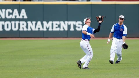 Louisiana Tech infielder Chandler Hall, second from right, catches a Cal State Fullerton pop up during an NCAA college regional baseball tournament game in Starkville, Miss., Sunday.