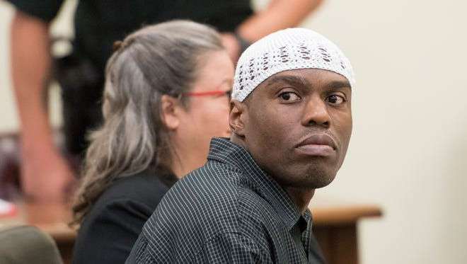 Shawn Rogers listens to testimony during his trial at the Santa Rosa Courthouse in Milton on Thursday, Aug. 3, 2017.  Rogers, 36, is on trial for allegedly attacking and murdering his cellmate, Ricky D. Martin, at the Santa Rosa Correctional Institution in March 2012.