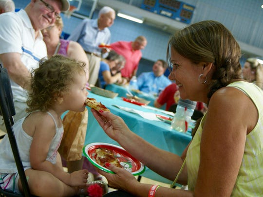 Kay Bostwick feeds pizza to her granddaughter, Sawyer, 23 months, during the ninth annual Taste of Gallatin held at the Gallatin Civic Center on Thursday, June 2.