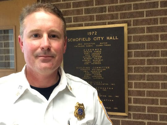 Schofield Assistant Fire Chief Troy Champan poses for a photo in Schofield City Hall on Feb. 9, 2016.
