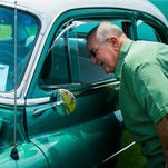 Ronnie Skaggs, 72, of Shepherdsville, admires Charles Garrett's 52 Oldsmobile 88 that contains all original parts during the Bullitt Blast Car Show in Shepherdsville, Ky. hosted by the Louisville Lead-Rod Custom Car Club. Saturday July 4, 2015 (Photo: William DeShazer, Special to The C-J)