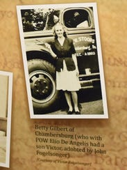Betty Gilbert's photo is displayed on a bulletin board