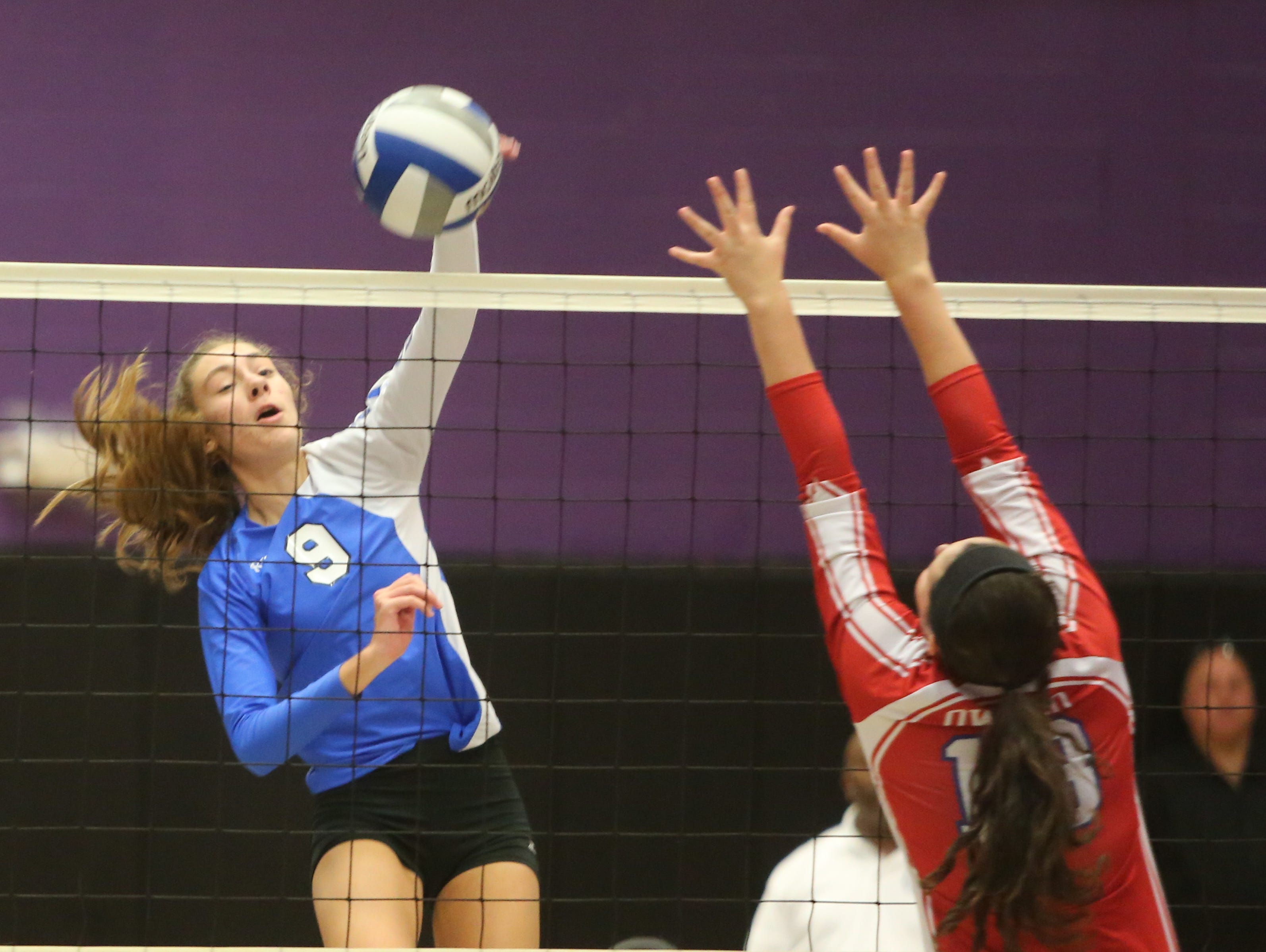 Hen Hud's Zoe Staats returns a shot to Owego during the Class B regional final between Hendrick Hudson and Owego at John Jay High School in Cross River, Nov. 14, 2015. Hen Hud lost to Owego in five games.