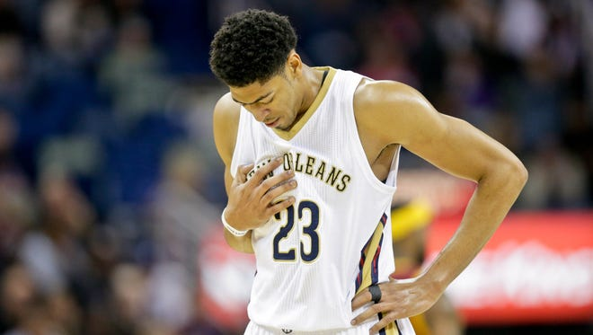 New Orleans Pelicans forward Anthony Davis (23) walks off the court after suffering a chest injury during the first quarter of a game last week against Cleveland.