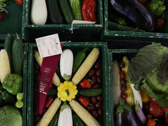 Vegetables entered in contest on display in the Agriculture Building during the Iowa State Fair on Wednesday, Aug. 17, 2016, in Des Moines.