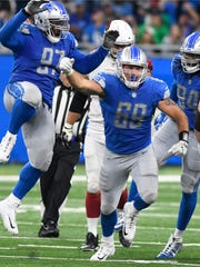Lions defensive end Anthony Zettel (69) celebrates after sacking Cardinals quarterback Carson Palmer in the second half Sunday, Sept. 10, 2017 at Ford Field.