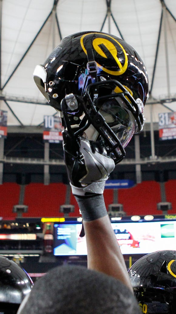 A Grambling State player raises his helmet prior to