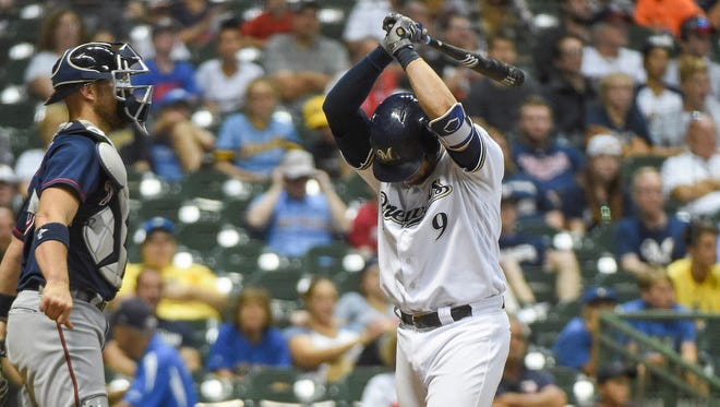 Brewers catcher Manny Pina lets his frustration show after striking out in the ninth inning Wednesday night at Miller Park.