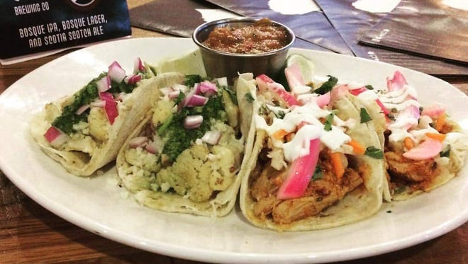 The Roasted Cauliflower and Pulled Pork Tacos served at Bosque Brewing Co. Public House make for a well-portioned meal.