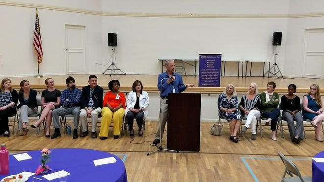 Paul Knoll speaks at Mental Health Awareness event with guest panelists.