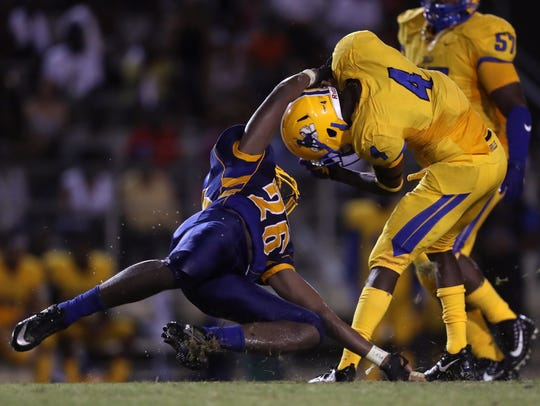 Rickards' Jaden Barber-Lee tries to tackle Miami Northwestern's